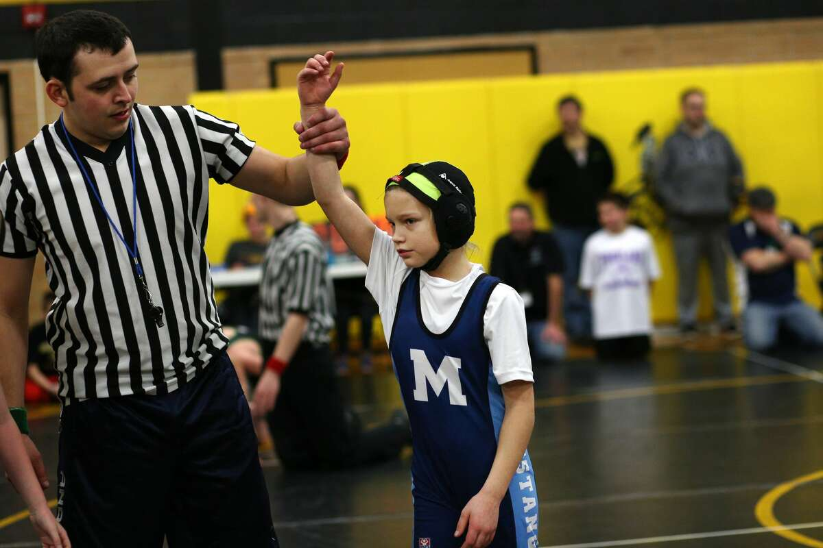 Harley Claypool of Meridian Youth Wrestling pins her opponent during the Bullock Creek Youth Wrestling Tournament on Saturday, Jan. 13, 2018. (Samantha Madar/for the Midland Daily News)