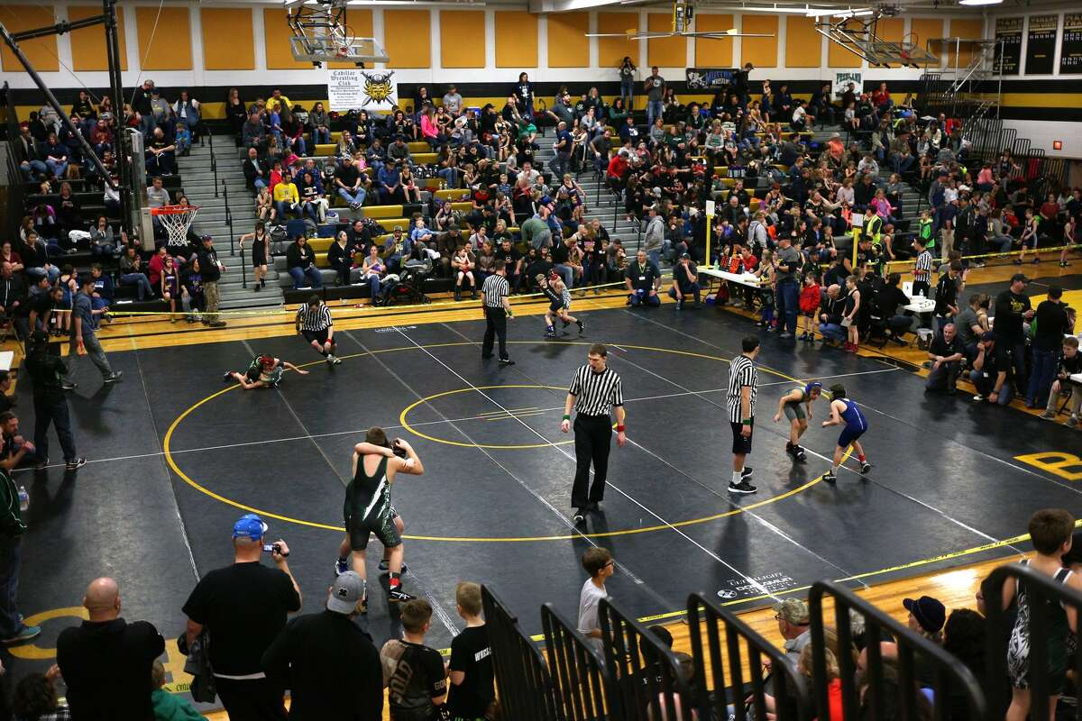 Nearly 400 wrestlers compete during the Bullock Creek Youth Wrestling Tournament on Saturday, Jan. 13, 2018. (Samantha Madar/for the Midland Daily News)
