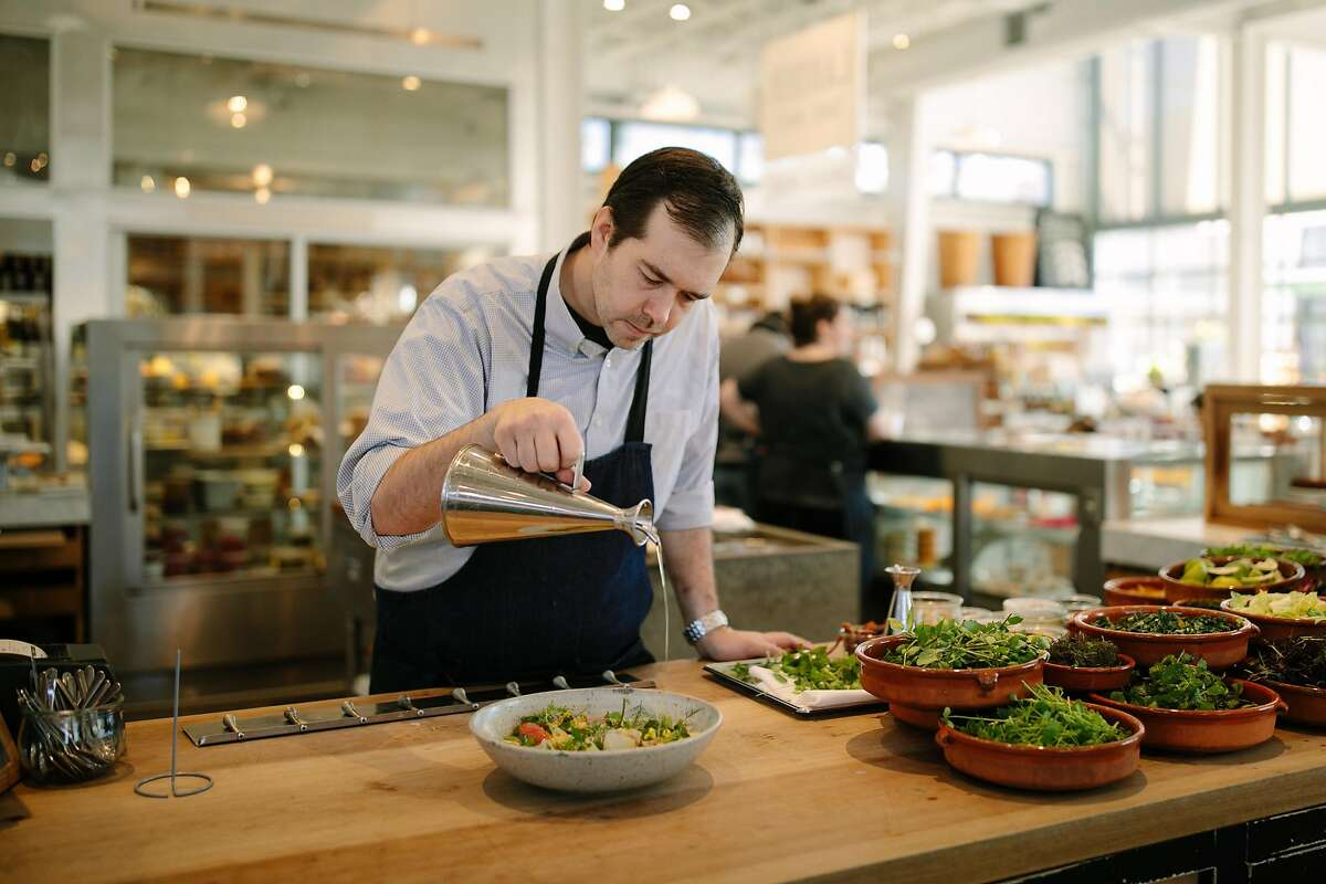Perry Hoffman prepares a salad with local and in season ingredients at the Shed in Healdsburg, Calif. Saturday, Jan. 6, 2018.