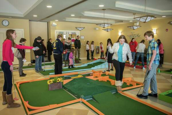 Families and friends at last year's event enjoy a round of indoor mini-golf at the Woodbury Senior Community Center. This year's fundraiser will be held on President's Day weekend, Feb. 16-19.