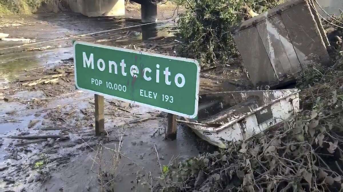 A sign for the town of Montecito on U.S. 101 shows the volume of debris that remains to be cleared.