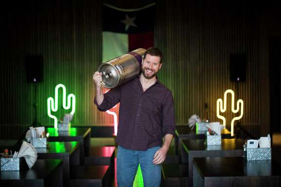 Master Sommelier David Keck with a wine keg of  McPherson Les Copains at his new classy honky-tonk Goodnight Charlie's located in Montrose, Wednesday, Jan. 3, 2018, in Houston. ( Marie D. De Jesus / Houston Chronicle )