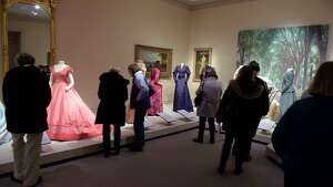 Visitors look over the exhibit, Well Dressed in Victorian Albany, 19th Century Fashion, during a free admission day at the Albany Institute of History and Art on Monday, Jan. 15, 2018, in Albany, N.Y.  (Paul Buckowski/Times Union)