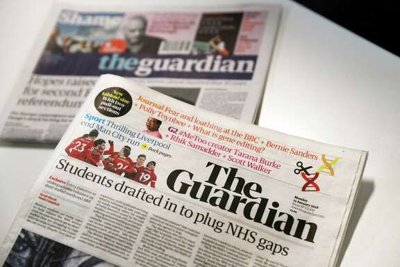 The new look tabloid Guardian is on show next to the old broadsheet version of the national newspaper on January 15, 2018. Britain's Guardian newspaper has adopted a new tabloid format and a re-designed masthead with simple black lettering from Monday as part of a drive to cut costs. The left-leaning newspaper previously had a blue and white masthead and in 2005 had adopted a Berliner format, midway between a broadsheet and a tabloid.