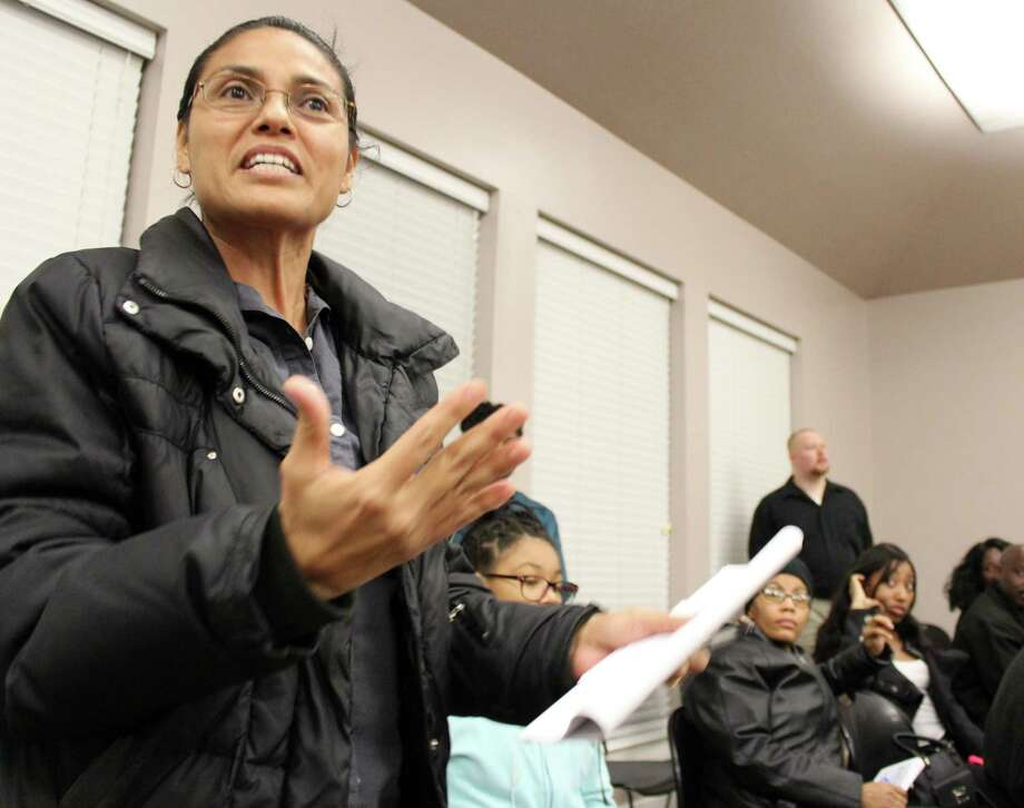 A crowd of roughly 150 Fresno and Missouri City-area residents at a recent town hall meeting voiced concerns to state and Fort Bend County officials about Hurricane Harvey flooding, ongoing issues related to illegal trash dumping, problems with the neighborhood trash services and an oil well blowout that caused a bad odor for weeks last December. Photo: Kristi Nix / HCN Staff