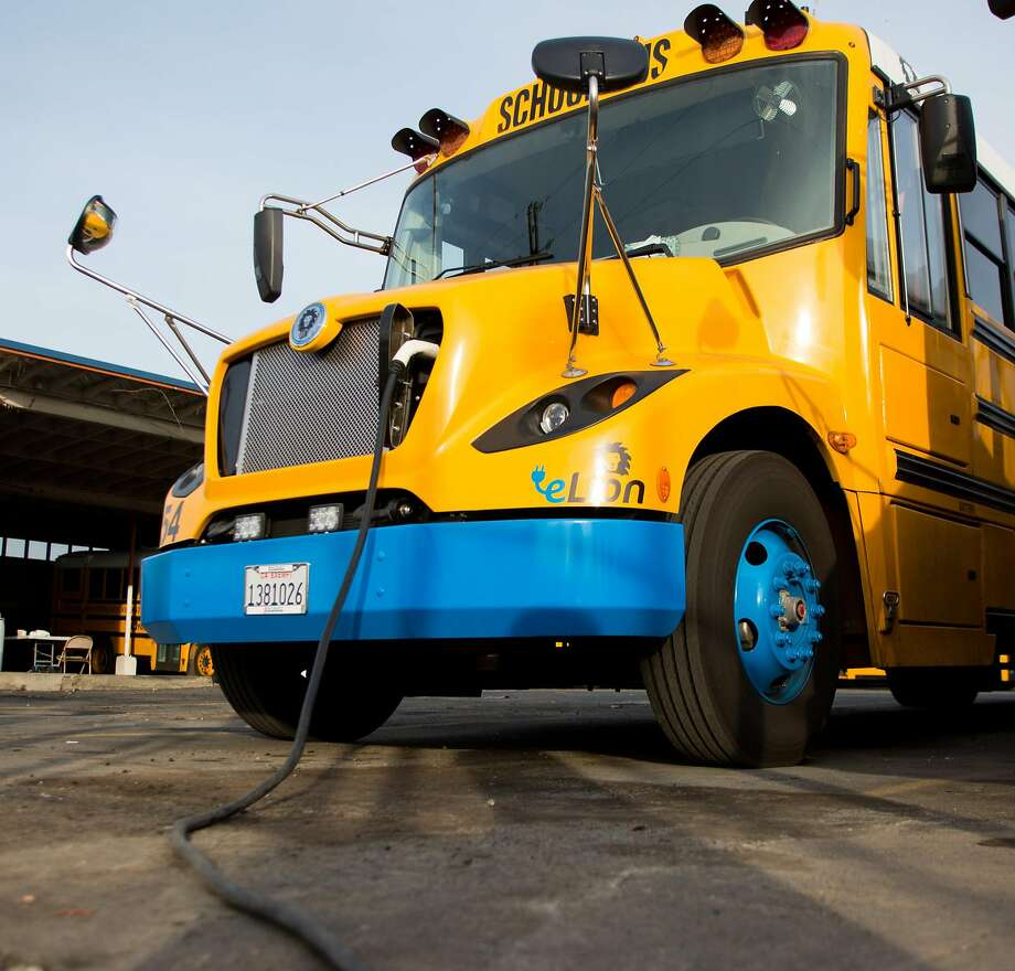 An electric school buses charges  in Sacramento.The buses require several hours to obtain a full charge and are plugged in immediately after a route. Photo: Austin Steele, Special To The Chronicle