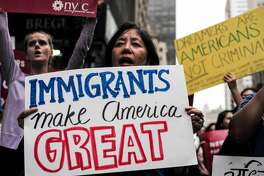 "(FILES) This file photo taken on October 05, 2017 shows protesters during a demonstration against US President Donald Trump during a rally in support of the Deferred Action for Childhood Arrivals (DACA), also known as Dream Act, near the Trump Tower in New York. US President Donald Trump said January 14, 2018 a deal to resolve the status of hundreds of thousands of immigrants who entered the United States illegally as children is ""probably dead,"" blaming it on Democrats.Trump came back on the issue in a pair of early morning tweets three days after igniting outrage by referring to African and Haitian immigrants as coming from ""shithole countries.""  / AFP PHOTO / Jewel SAMADJEWEL SAMAD/AFP/Getty Images"