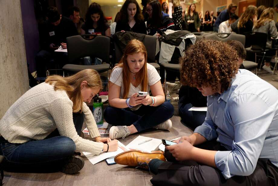 Lily Lorenzen (left), Aliza Mayer, and Jacob Lauter work on a project at a workshop for teens learning how to become activists. Photo: Carlos Avila Gonzalez, The Chronicle