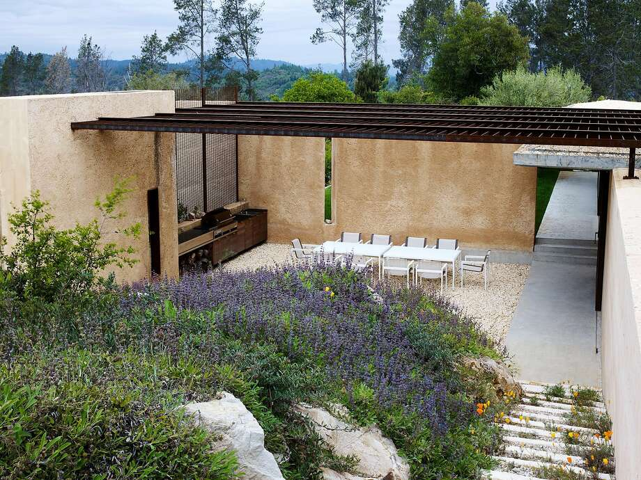 A mix of salvias hold a hillside at the Calistoga home and garden of Richard and Tatwina Lee, where walls are used to both focus the view and provide wind protection. Photo: Marion Brenner, Marion Brenner / The Monacelli Press