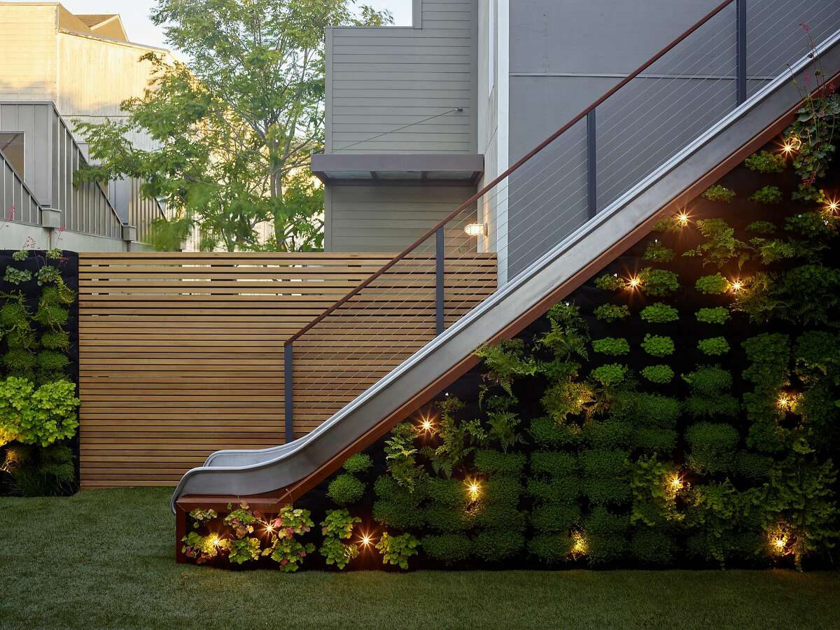 """Designer Monica Viarengo added a living wall of succulents to a children�s slide for a drought-tolerant garden. The grass is actually artificial turf � a durable year-round play surface. Image courtesy The Monacelli Press, """"Private Gardens of the Bay Area,� by Susan Lowry and Nancy Berner."""