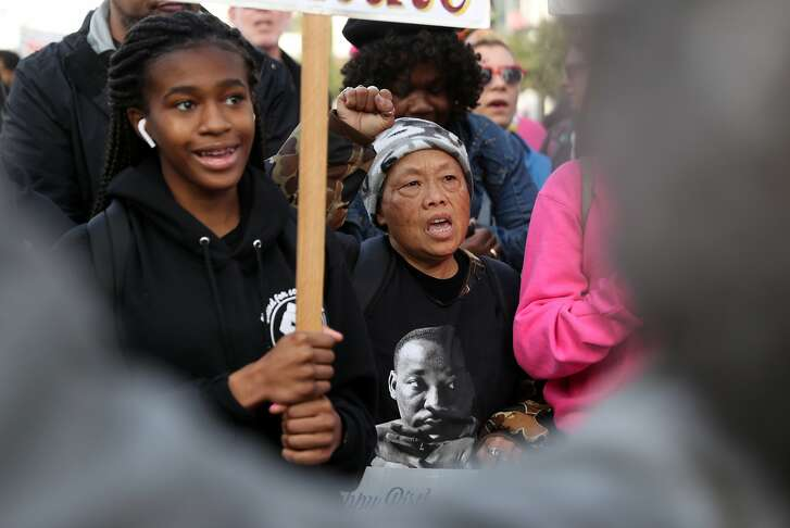 Mercy Wong (center) marches down 4th Street on Martin Luther King, Jr. Day  in San Francisco, Calif., on Monday, January 15, 2018.