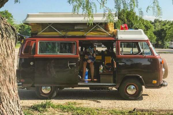 They've lived in a VW, then an Airstream, and are back in a van again. The eldest sleeps outside in a tent for privacy.