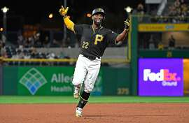 PITTSBURGH, PA - SEPTEMBER 26:  Andrew McCutchen #22 of the Pittsburgh Pirates reacts as he rounds the bases after hitting a grand slam home run in the second inning during the game against the Baltimore Orioles at PNC Park on September 26, 2017 in Pittsburgh, Pennsylvania. The grand slam home run was the first of McCutchen's career. (Photo by Justin Berl/Getty Images)