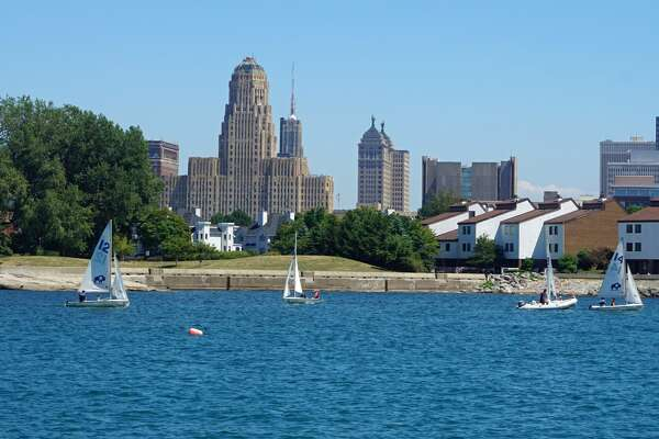 Sailboats in Buffalo Harbor With Buffalo Skyline, Buffalo, New York, USA. (Photo by: Education Images/UIG via Getty Images)