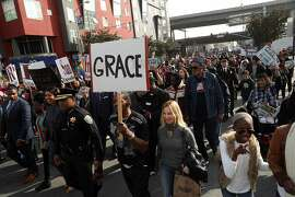 Marchers head north on 3rd Street on Martin Luther King, Jr. Day  in San Francisco, Calif., on Monday, January 15, 2018.
