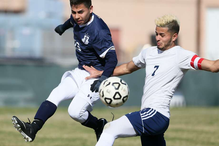 ac85a12cf34 Roosevelt s Ricardo Moreno (right)) fights for the ball with Central  Catholic s Jacob Jones
