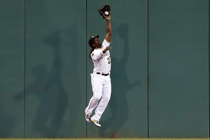 Pittsburgh Pirates center fielder Andrew McCutchen leaps to catch a fly ball by St. Louis Cardinals' Matt Carpenter in the third inning of the baseball game on Tuesday, Aug. 26, 2014, in Pittsburgh. (AP Photo/Keith Srakocic)