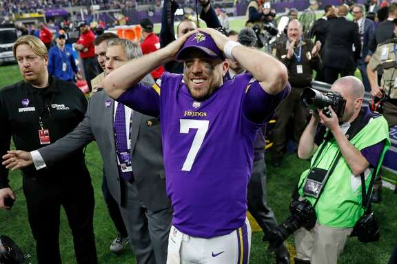 Minnesota Vikings quarterback Case Keenum celebrates following an improbable 29-24 win over the New Orleans Saints in an NFL divisional football playoff game in Minneapolis, Sunday, Jan. 14, 2018.