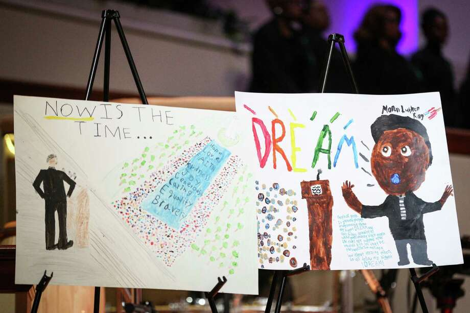 Award winning posters made by local elementary students stand on display during the Martin Luther King, Jr. Day celebration on Monday, Jan. 15, 2018, at The Woodlands United Methodist Church. Photo: Michael Minasi, Staff Photographer / © 2017 Houston Chronicle