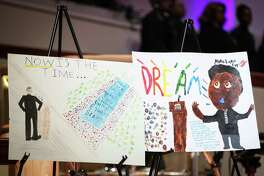 Award winning posters made by local elementary students stand on display during the Martin Luther King, Jr. Day celebration on Monday, Jan. 15, 2018, at The Woodlands United Methodist Church.