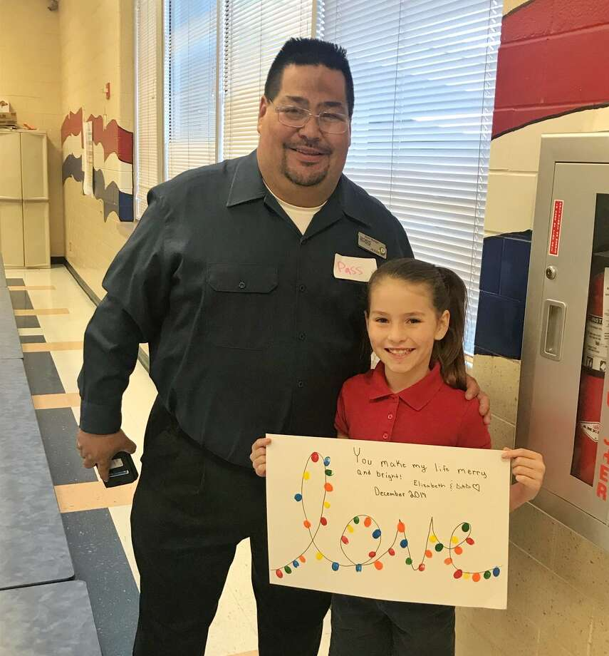 """Rusk Elementary's """"Donuts with Dad"""" Photo: Midland ISD"""
