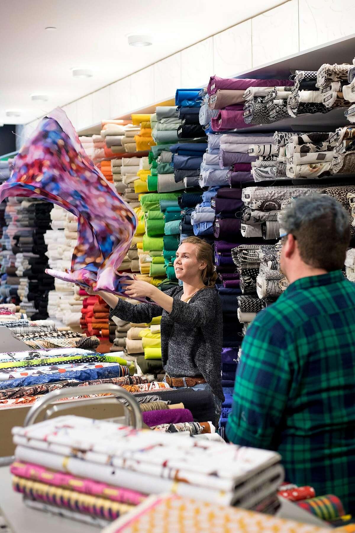 Lindsey Eifert displays fabric at Britex Fabrics on Tuesday, Jan. 9, 2018, in San Francisco.
