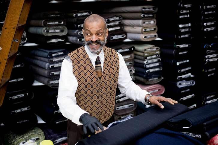 Sporting a custom made wardrobe, Douglas Davis arranges material at Britex Fabrics on Tuesday, Jan. 9, 2018, in San Francisco. Davis has worked at the store for 27 years.