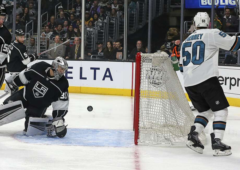 San Jose Sharks enter Chris Tierney (50) scores a goal against Los Angeles Kings goalie Darcy Kuemper (35) in the first period of an NHL hockey game in Los Angeles Monday, Jan. 15, 2018. (AP Photo/Reed Saxon) Photo: Reed Saxon, Associated Press
