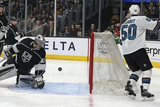 San Jose Sharks enter Chris Tenney (50) scores a goal against Los Angeles Kings goalie Darcy Kuemper (35) in the first period of an NHL hockey game in Los Angeles Monday, Jan. 15, 2018. (AP Photo/Reed Saxon)