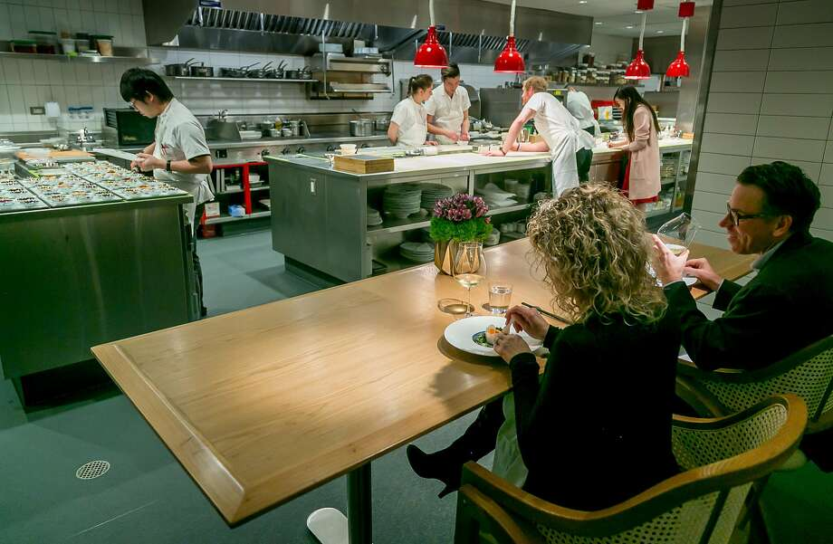 Dining at the chef's table in the kitchen at Eight Tables in S.F. Photo: John Storey, Special To The Chronicle