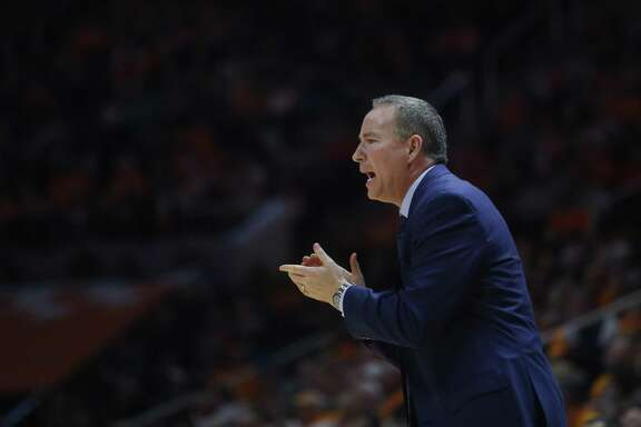 Texas A&M head coach Billy Kennedy claps for his team in the second half of an NCAA college basketball game against Tennessee on Saturday, Jan. 13, 2018, in Knoxville, Tenn. (AP Photo/Crystal LoGiudice)