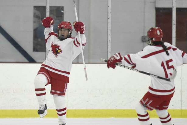 Greenwich'sJen Kelly, left, celebrates her goal with teammate Katie Piotrzkowski on Monday at Dorothy Hamill Skating Rink in Greenwich.