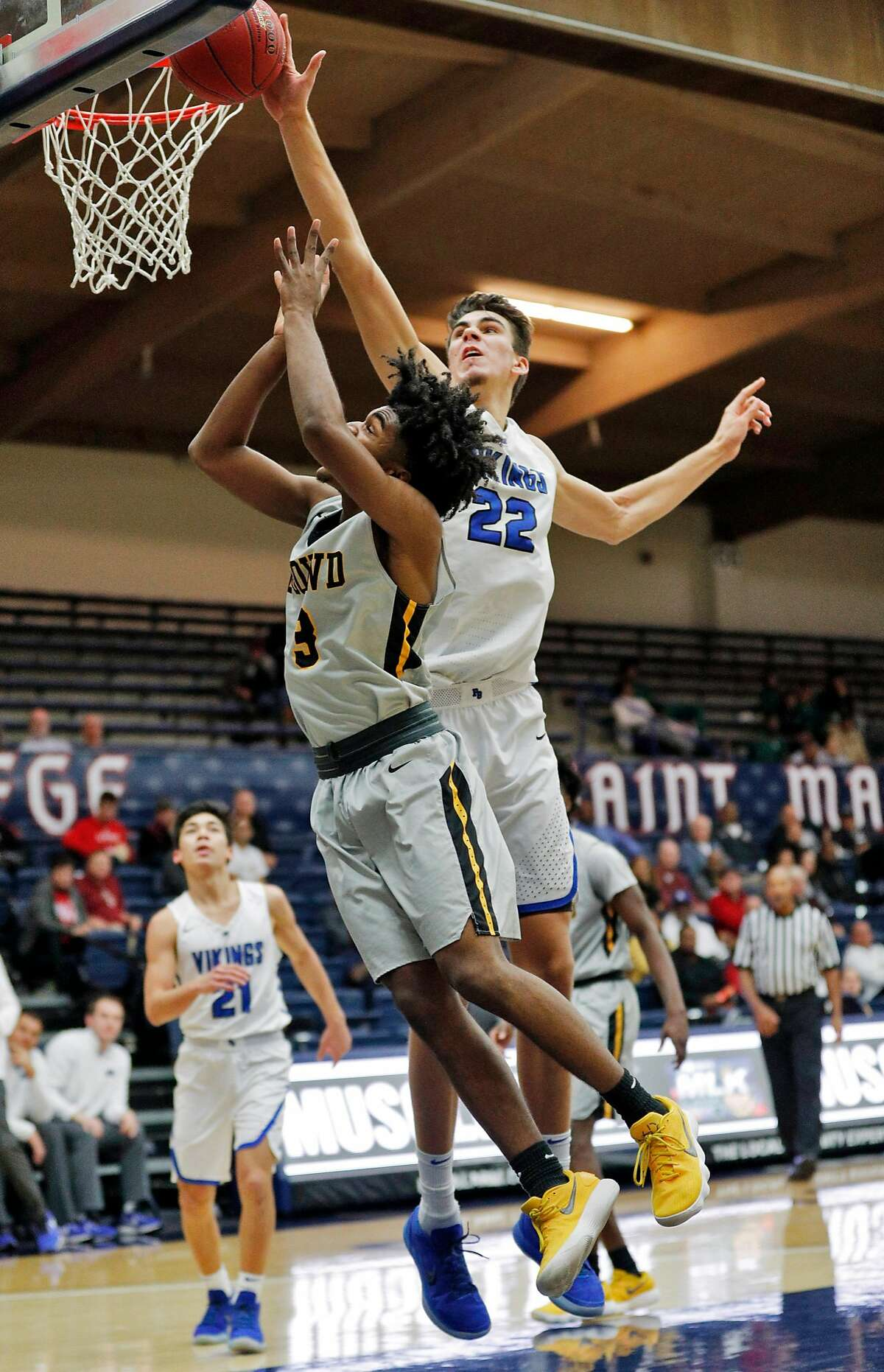 Matt Van Komen (22) blocks a shot by Brendan Patrick (3) in the first half as the Bishop O'Dowd Dragons played the Pleasant Grove (Utah) Vikings at the Martin Luther King, Jr. Classic at St. Mary's College in Moraga, Calif., on Monday, January 15, 2018.