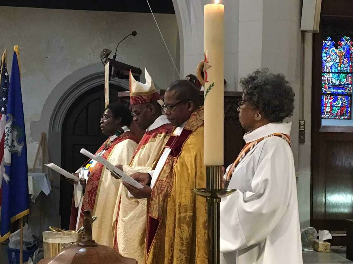 The Right Rev. Nathan D. Baxter, second from left, leads MLK Day service Monday, with, from left, the Rev. Charles Kamano, the Rev. Judith Alexis and the Rev. Canon Diane Peterson. The Union of Black Episcopalians' Southern Connecticut Chapter organized a eucharistic celebration of the life of the late Rev. Dr. Martin Luther King Jr. on Monday, Jan. 15, 2018 in the Church of the Holy Spirit on Church Street in West Haven.
