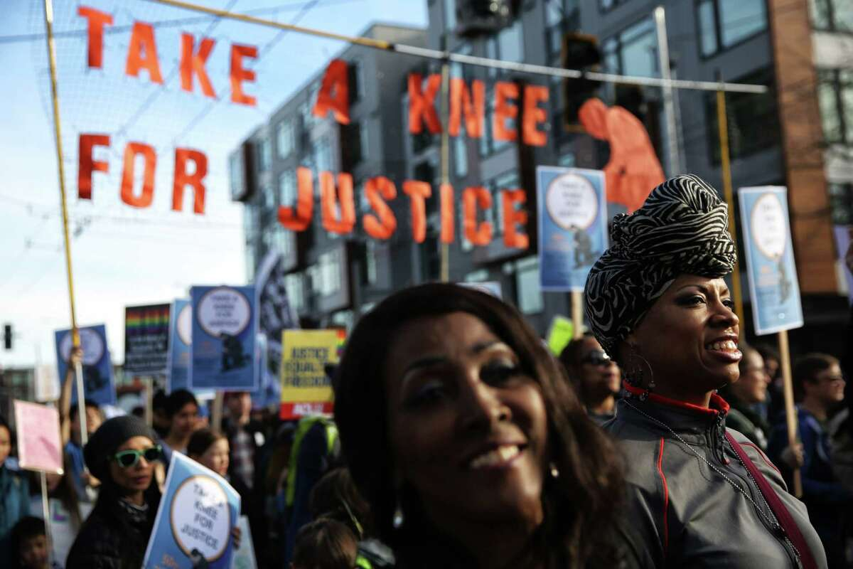 Thousands participate in the annual Martin Luther King Day march from Garfield High School to Westlake Park, Monday, Jan. 15, 2018. This year the march was themed
