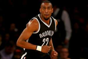 NEW YORK, NY - APRIL 01:  Markel Brown #22 of the Brooklyn Nets celebrates his shot in the first half against the New York Knicks at Madison Square Garden on April 1, 2016 in New York City. NOTE TO USER: User expressly acknowledges and agrees that, by downloading and or using this photograph, User is consenting to the terms and conditions of the Getty Images License Agreement.  (Photo by Elsa/Getty Images)