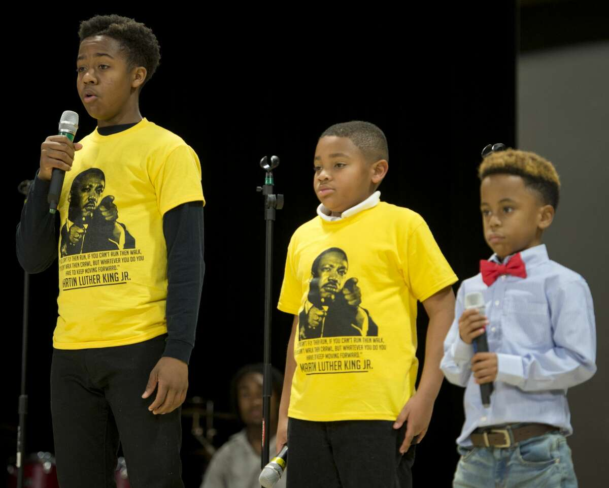 """Jaykala H. Reed, Aaron Colvin and Leroy Thomas III recite part of the Martin Luther King Jr. speech """"I Have a Dream"""" 01/15/18 at the Martin Luther King Jr. Celebration at the MLK Center. Tim Fischer/Reporter-Telegram"""