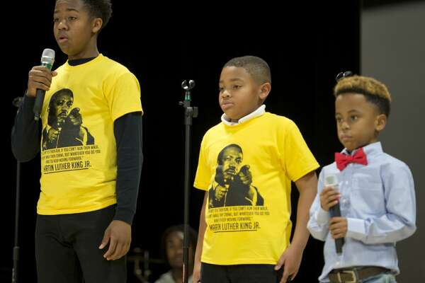 "Jaykala H. Reed, Aaron Colvin and Leroy Thomas III recite part of the Martin Luther King Jr. speech ""I Have a Dream"" 01/15/18 at the Martin Luther King Jr. Celebraton at the MLK Center. Tim Fischer/Reporter-Telegram"