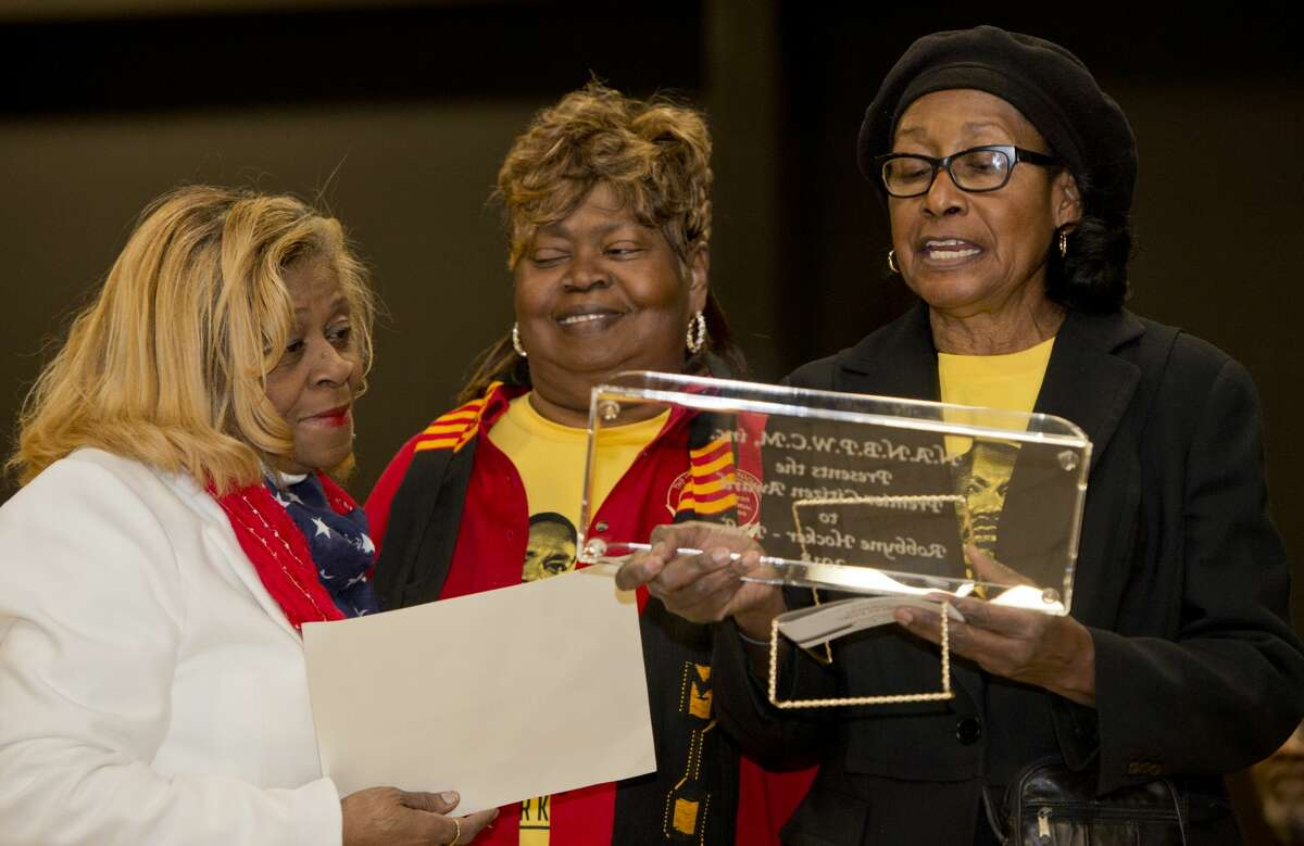 Shirley Howard, center, president and Emma Threat, vice president of the Negro Business & Professional Women's Club of Midland, present Robbyne Hocker Fuller with the Premiere Citizen Award 01/15/18 at the Martin Luther King Jr. Celebration at the MLK Center. Tim Fischer/Reporter-Telegram