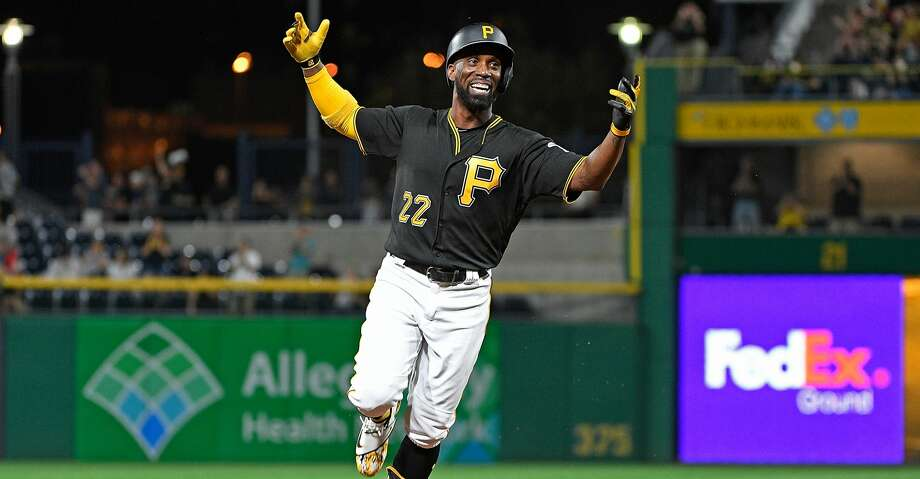PITTSBURGH, PA - SEPTEMBER 26:  Andrew McCutchen #22 of the Pittsburgh Pirates reacts as he rounds the bases after hitting a grand slam home run in the second inning during the game against the Baltimore Orioles at PNC Park on September 26, 2017 in Pittsburgh, Pennsylvania. The grand slam home run was the first of McCutchen's career. (Photo by Justin Berl/Getty Images) Photo: Justin Berl/Getty Images