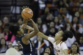 UConn's Crystal Dangerfield, left, shoots over Texas guard Brooke McCarty during the first half Monday in Austin, Texas.