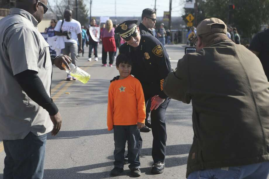 Police Chief William McManus poses with Jacob De La Fuentes, 6, at the Martin Luther King Jr. Day march. Readers differ on the   chief's decision  to release 12 undocumented immigrants. Photo: John Davenport / San Antonio Express-News / ©John Davenport/San Antonio Express-News