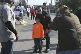 Police Chief William McManus poses with Jacob De La Fuentes, 6, at the Martin Luther King Jr. Day march. Readers differ on the   chief's decision  to release 12 undocumented immigrants.