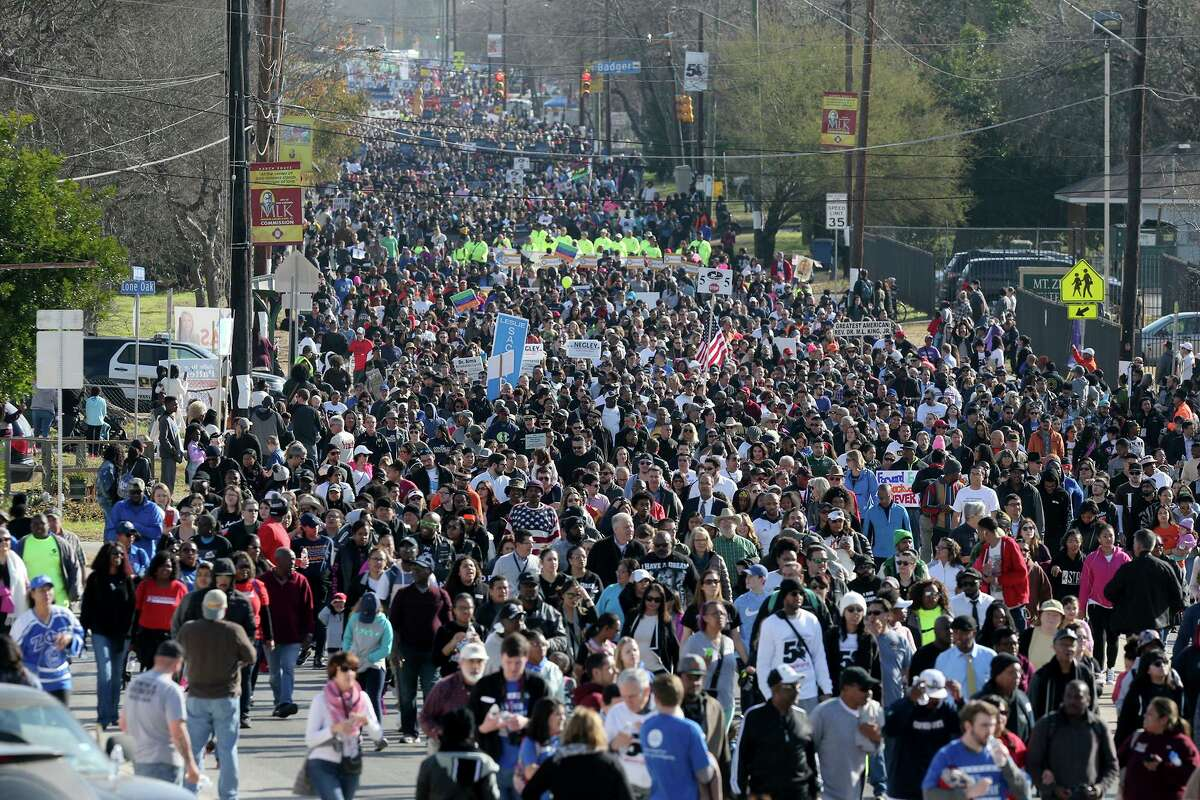 The Martin Luther King Day march makes its way down Martin Luther King Boulevard Monday January 15, 2018.
