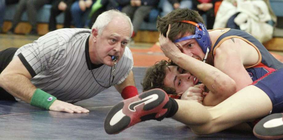 Danbury's Nic Savo, top, has the upper hand in the 120-pound match against Mount Anthony's Gaige Crandall, bottom, seconds before the referee signaled Savo had won by pin during the wrestling match at Danbury High School Jan. 15, 2018. Photo: Richard Gregory / Richard Gregory