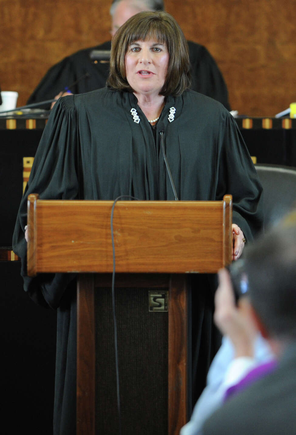 U.S. District Judge Mae D'Agostino speaks after being sworn in by Chief Judge Norman A. Mordue at the Federal Courthouse in Albany, N.Y. on Monday, Sept. 19, 2011. (Lori Van Buren / Times Union)