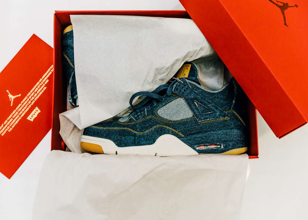 Levi's Air Jordan IV sneakers and matching trucker jacket. Photo: Courtesy/ NIKE