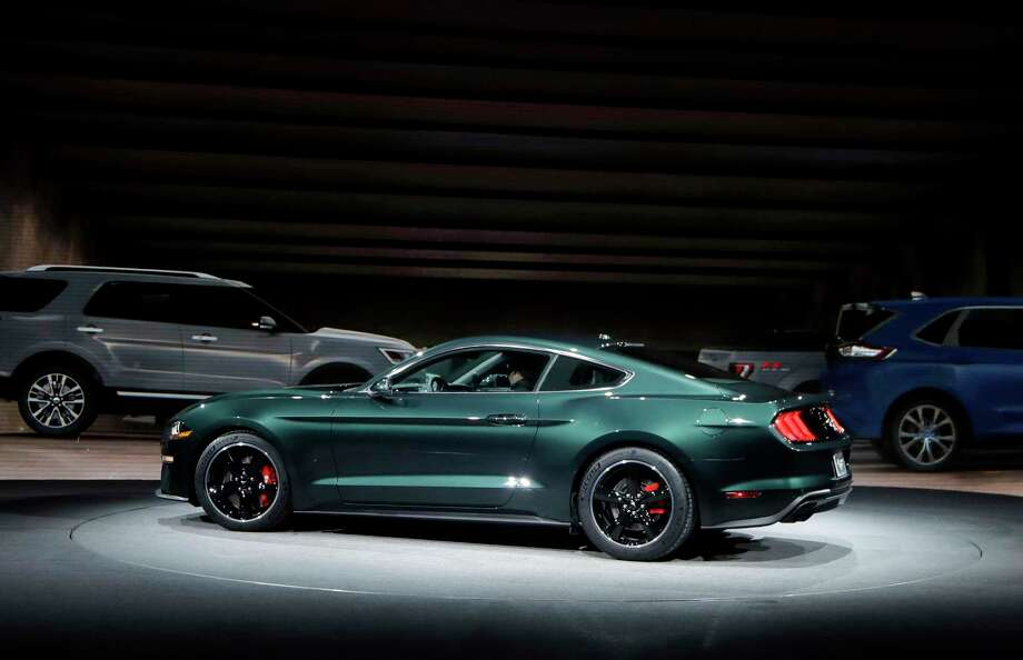 "Celebrating the 50th anniversary of iconic movie ""Bullitt"" and its fan-favorite San Francisco car chase, Ford introduces the new 2019 Mustang Bullitt at the North American International Auto Show, Sunday, Jan. 14, 2018, in Detroit. (AP Photo/Carlos Osorio) Photo: Carlos Osorio, STF / Copyright 2018 The Associated Press. All rights reserved."
