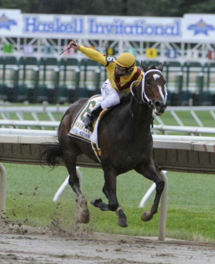 Jockey Calvin Borel heads to a six-length victory Sunday aboard Rachel Alexandra in the Haskell Invitational at Monmouth Park in Oceanport, N.J. ( Skip Dickstein / Times Union)