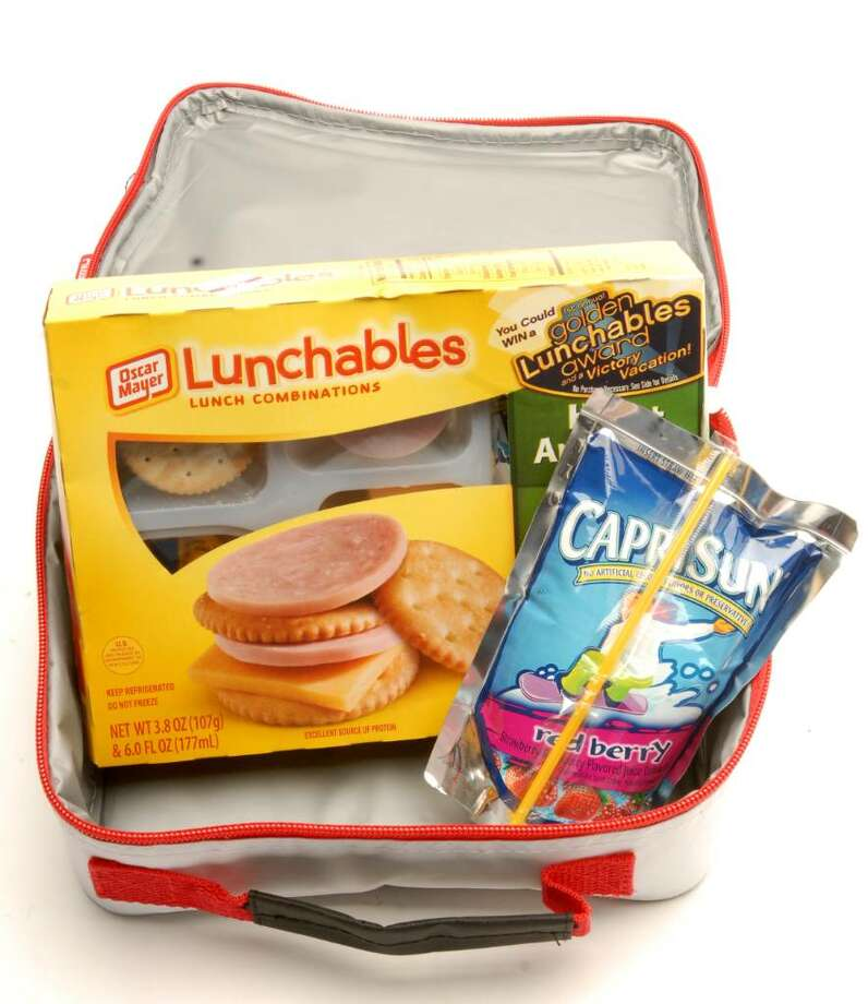 "This lunch gets a ""C"" for nutrition. Lunchables are high in sodium and preservatives; candy can lead to a sugar high and subsequent crash; chips and cookies in a sandwich bag mean no portion control; while sugary juice drinks up calorie content without offering satiation. (Luanne M. Ferris / Times Union) Photo: LUANNE M. FERRIS / 00005255A"